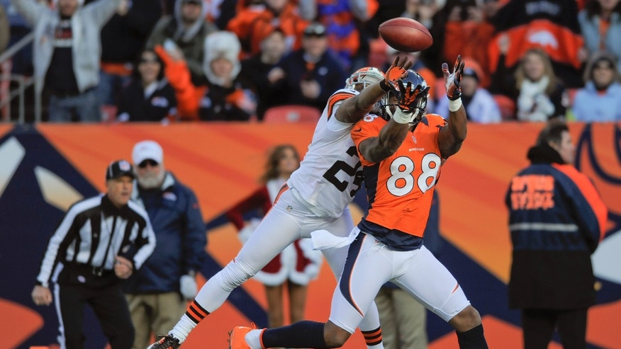 Denver Broncos wide receiver Demaryius Thomas (88) catches a pass for a touchdown  against Cleveland Browns cornerback Sheldon Brown (24) in the first quarter of an NFL football game, Sunday, Dec. 23, 2012, in Denver. (AP Photo/Jack Dempsey)