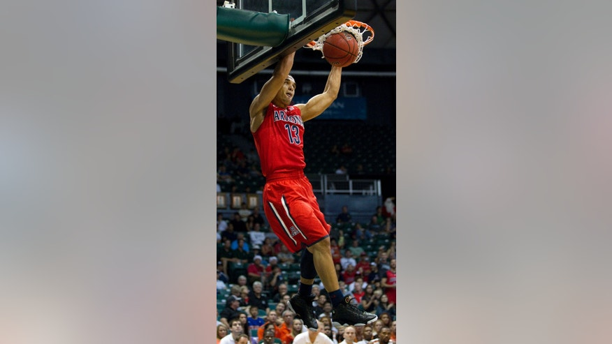 Arizona guard Nick Johnson (13) breaks away for a dunk against Miami in the first half of an NCAA college basketball game in the Diamond Head Classic Sunday, Dec. 23, 2012, in Honolulu. (AP Photo/Eugene Tanner)