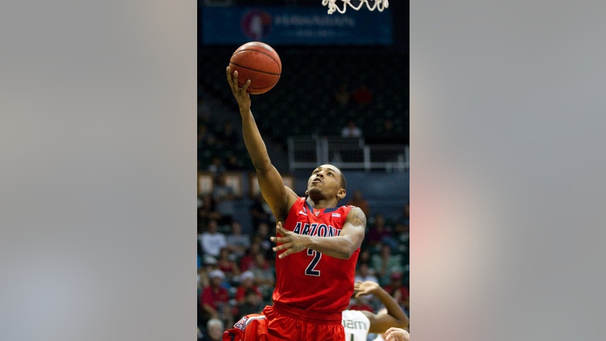 Arizona guard Mark Lyons (2) shoots a layup against Miami in the first half of an NCAA college basketball game in the Diamond Head Classic Sunday, Dec. 23, 2012, in Honolulu. (AP Photo/Eugene Tanner)