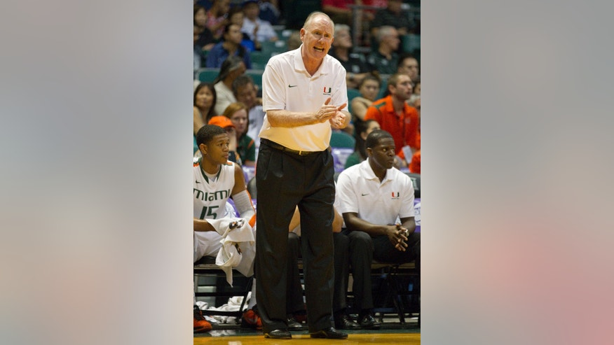 Miami head coach Jim Larranaga encourages his team as they play Arizona in the first half of an NCAA college basketball game in the Diamond Head Classic Sunday, Dec. 23, 2012, in Honolulu. (AP Photo/Eugene Tanner)