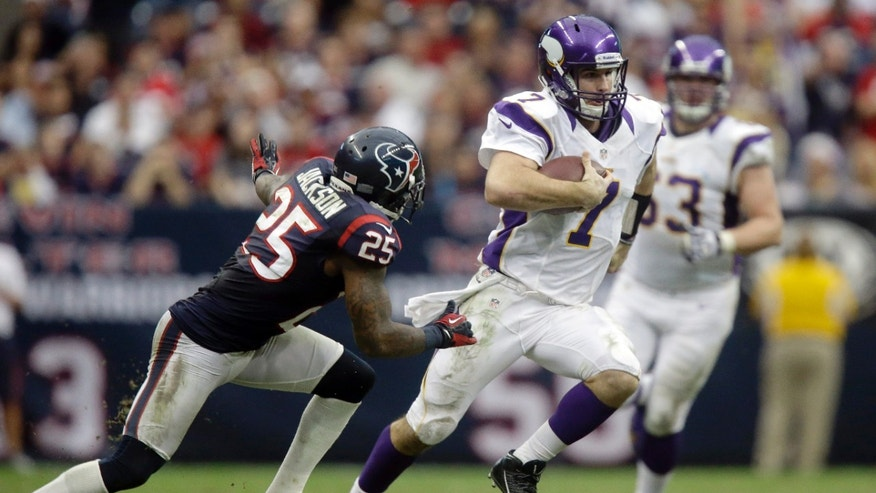 Minnesota Vikings quarterback Christian Ponder (7) runs for a first down as Houston Texans cornerback Kareem Jackson (25) defends during the fourth quarter of an NFL football game Sunday, Dec. 23, 2012, in Houston. The Vikings beat the Texans 23-6.  (AP Photo/Patric Schneider)