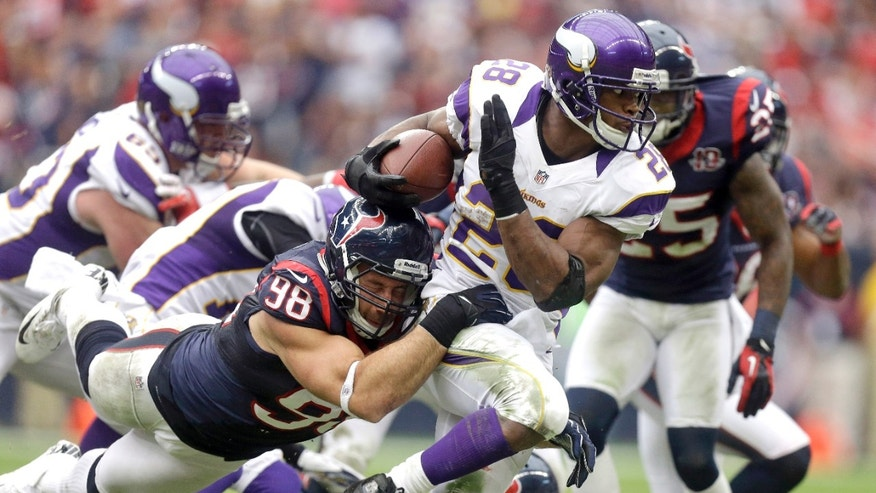 Minnesota Vikings running back Adrian Peterson (28) tries to turn upfield as Houston Texans' Connor Barwin (98) tackles him during the second quarter of an NFL football game Sunday, Dec. 23, 2012, in Houston. (AP Photo/Patric Schneider)