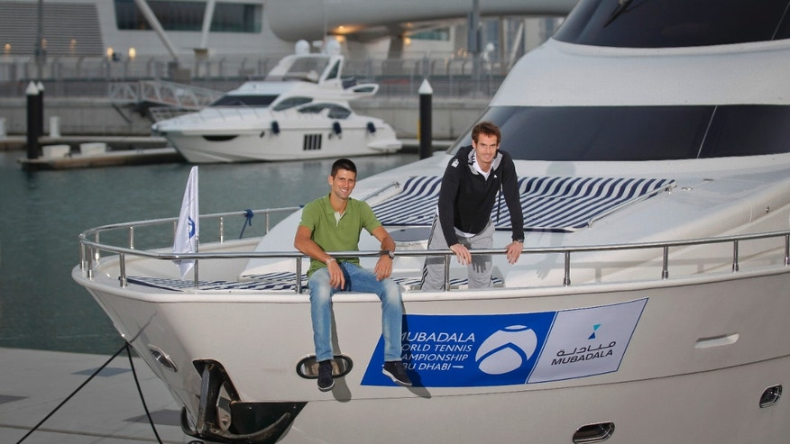 In This Handout photo dated Dec. 25, 2012 and made available by Mubadala World Tennis Championship, Serbian tennis player Novak Djokovic, left, and Andy Murray from Britain pose on a yacht a day ahead of Mubadala Tennis Championship in Abu Dhabi, United Arab Emirates. (AP Photo/Mubadala World Tennis Championship)