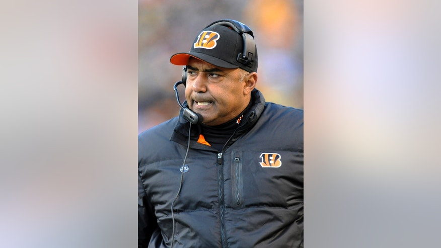 Cincinnati Bengals coach Marvin Lewis reacts to a penalty called on his team in the fourth quarter of an NFL football game against the Pittsburgh Steelers on Sunday, Dec. 23, 2012, in Pittsburgh. The Bengals defeated the Steelers 13-10. (AP Photo/Don Wright)