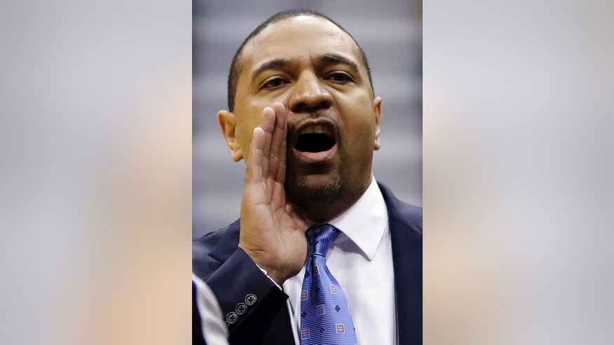Golden State Warriors head coach Mark Jackson shouts to his team in the first quarter of an NBA basketball game against the Utah Jazz, Wednesday, Dec. 26, 2012, in Salt Lake City. (AP Photo/Rick Bowmer)