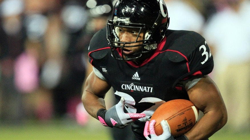 FILE - In this Oct. 13, 2012, file photo, Cincinnati running back George Winn carries the ball against Fordham during an NCAA college football game in Cincinnati. The Bearcats takes on Duke in the Belk Bowl on Thursday in Charlotte. (AP Photo/Al Behrman, File)