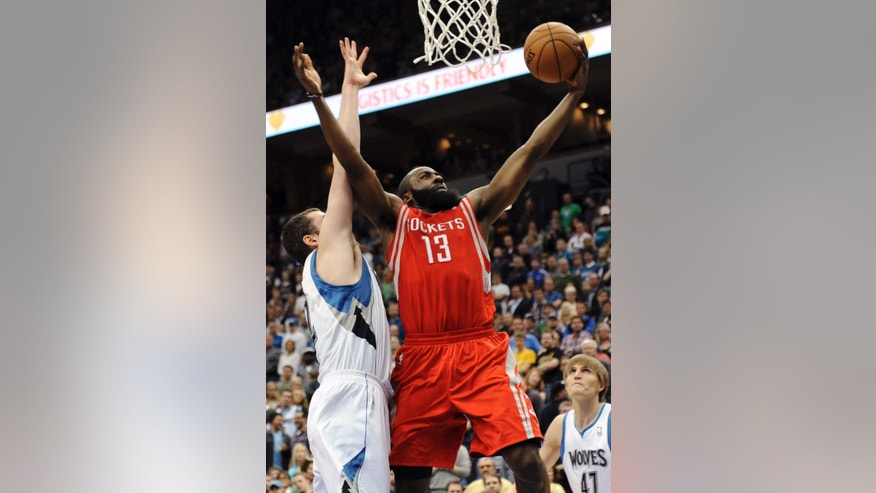 Houston Rockets' James Harden (13) shoots a layup as Minnesota Timberwolves' Kevin Love defends in the second half of an NBA basketball game, Wednesday, Dec. 26, 2012, in Minneapolis. Harden led the Rockets with 30 points in their 87-84 win. (AP Photo/Jim Mone)