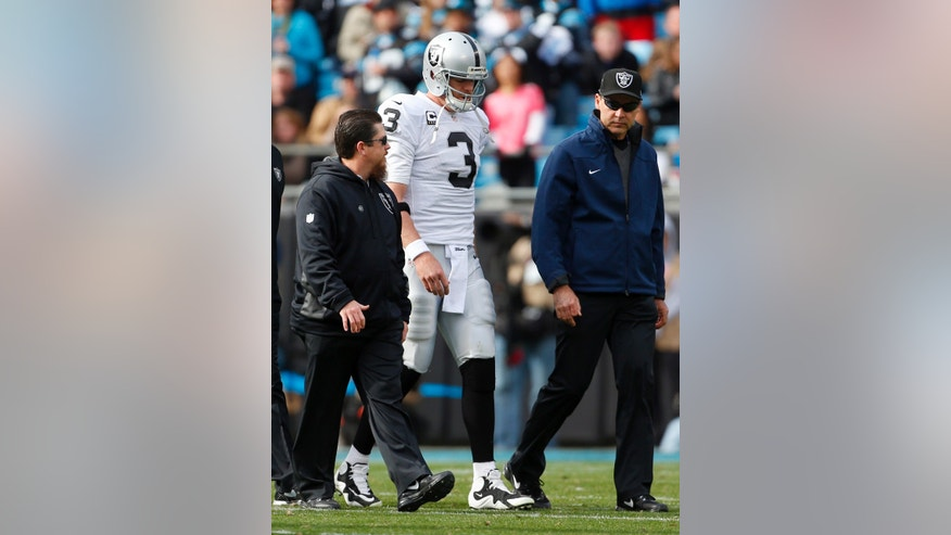 Oakland Raiders' Carson Palmer (3) walks off the field after being injured during the first half of an NFL football game against the Carolina Panthers in Charlotte, N.C., Sunday, Dec. 23, 2012. (AP Photo/Bob Leverone)