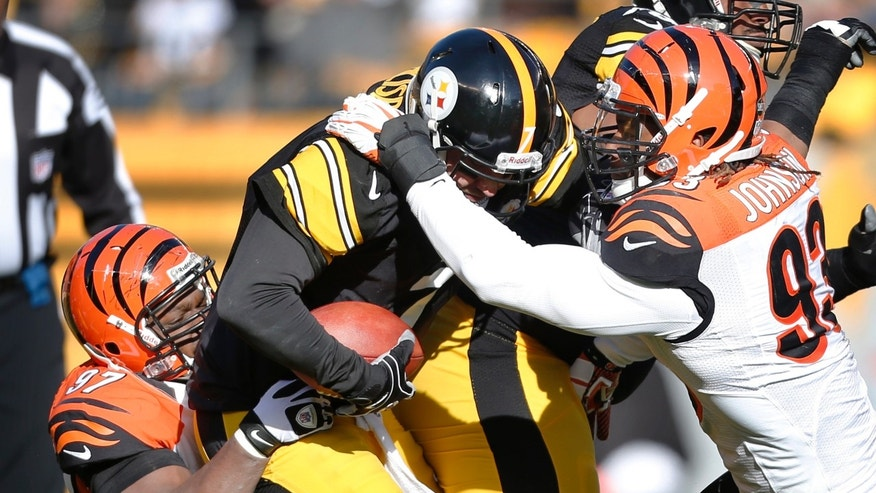 Pittsburgh Steelers quarterback Ben Roethlisberger (7) is sacked by Cincinnati Bengals defensive tackle Geno Atkins (97) and defensive end Michael Johnson (93) in the first quarter of their NFL football game on Sunday, Dec. 23, 2012, in Pittsburgh. (AP Photo/Keith Srakocic)