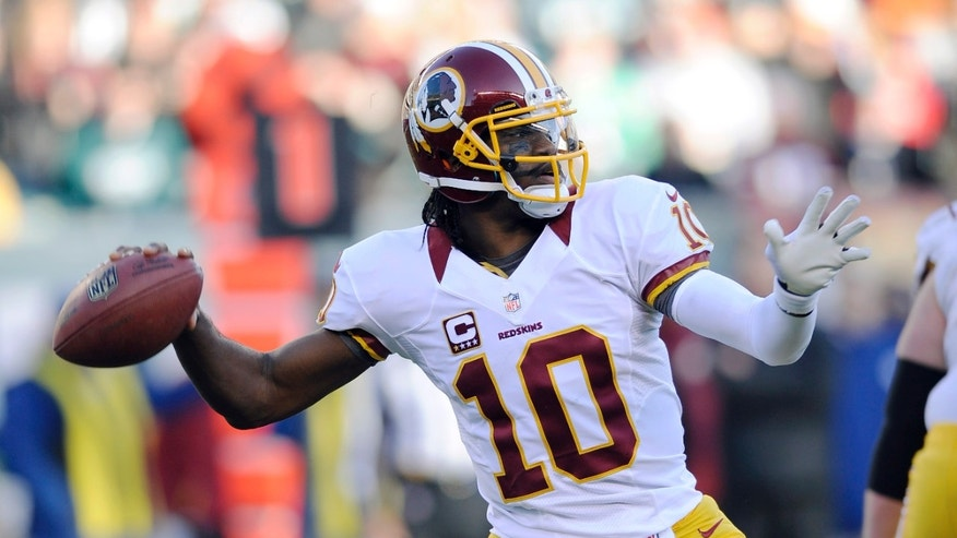 Washington Redskins' Robert Griffin III passes in the second half of an NFL football game against the Philadelphia Eagles, Sunday, Dec. 23, 2012, in Philadelphia. Washington won 27-20. (AP Photo/Michael Perez)