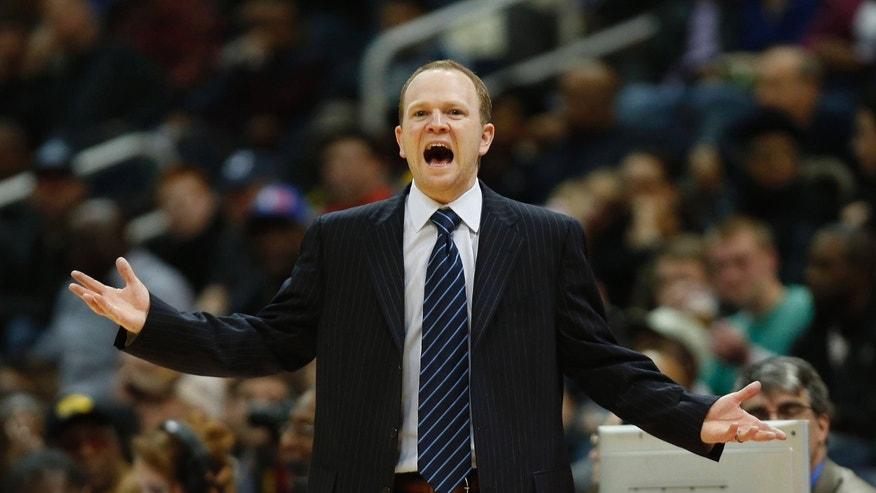 Detroit Pistons head coach Lawrence Frank reacts in the first half of an NBA basketball game against the Atlanta Hawks, Wednesday, Dec. 26, 2012, in Atlanta. (AP Photo/John Bazemore)