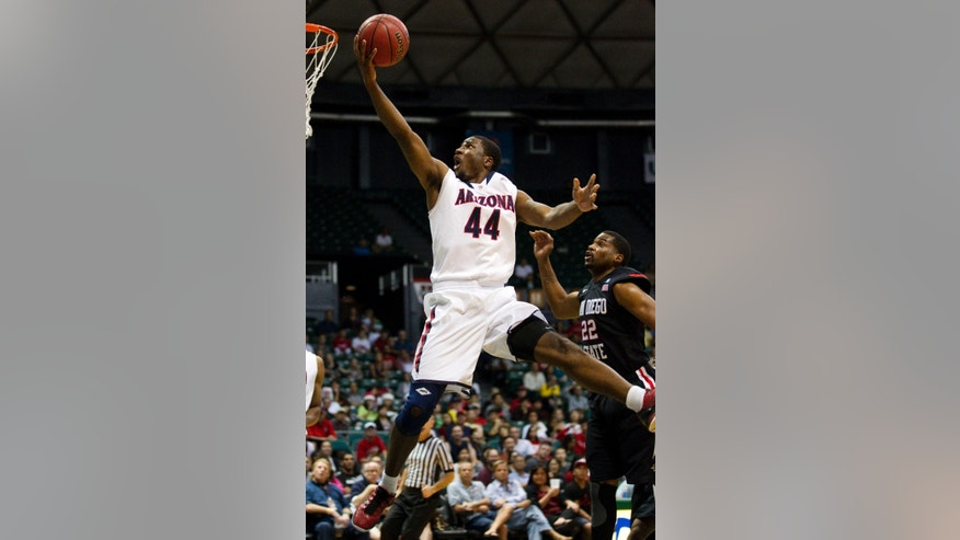 Arizona forward Solomon Hill (44) shoots a layup ahead of San Diego State guard Chase Tapley (22) in the first half of an NCAA college basketball game at the Diamond Head Classic, Tuesday, Dec. 25, 2012, in Honolulu. (AP Photo/Eugene Tanner)