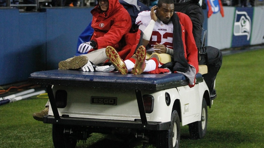 San Francisco 49ers' Mario Manningham (82) is taken off the field on a cart after suffering an injury in the second half of an NFL football game against the Seattle Seahawks, Sunday, Dec. 23, 2012, in Seattle. (AP Photo/John Froschauer)