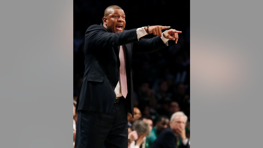 Boston Celtics head coach Doc Rivers directs his team from the bench in the second half of their NBA basketball game against the Brooklyn Nets at Barclays Center, Tuesday, Dec. 25, 2012, in New York. Boston won 93-76. (AP Photo/John Minchillo)