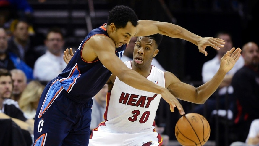Charlotte Bobcats' Gerald Henderson, left, drives past Miami Heat's Norris Cole (30) during the second half of their NBA basketball game, Wednesday, Dec. 26, 2012, in Charlotte. The Heat won 105-92. (AP Photo/The Charlotte Observer, David T. Foster III) MAGS OUT&#x3b; TV OUT&#x3b; NEWSPAPER INTERNET ONLY