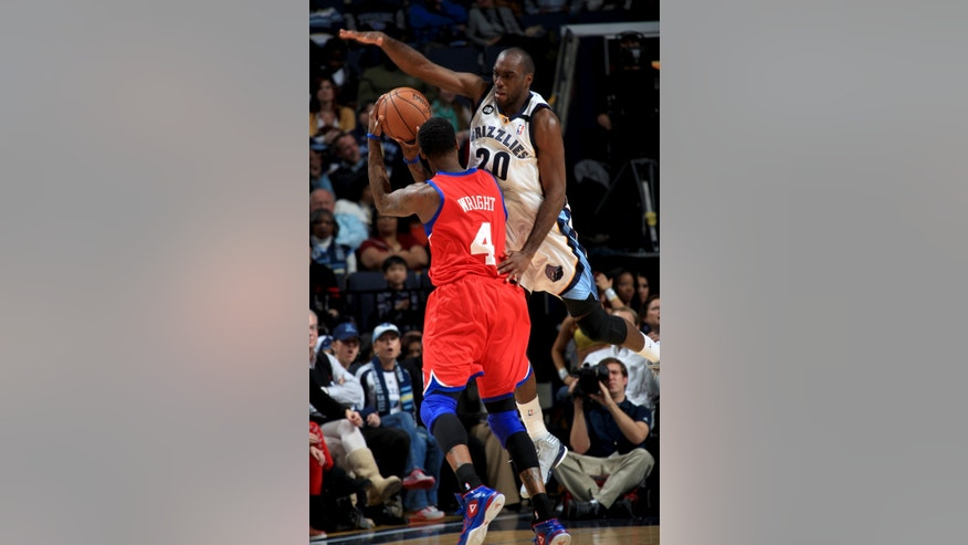 Philadelphia 76ers forward Dorell Wright (4) is fouled by Memphis Grizzlies guard Quincy Pondexter (20) in the first half of an NBA basketball game on Wednesday, Dec. 26, 2012, in Memphis, Tenn. (AP Photo/Nikki Boertman)