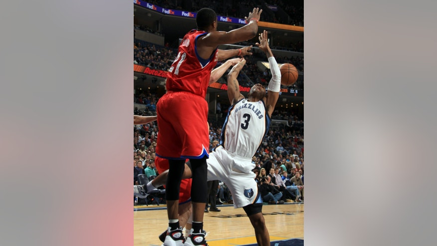 Memphis Grizzlies guard Wayne Ellington (3) has his shot blocked by Philadelphia 76ers forward Thaddeus Young (21) in the first half of an NBA basketball game on Wednesday, Dec. 26, 2012, in Memphis, Tenn. (AP Photo/Nikki Boertman)