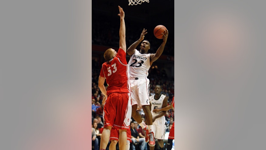 Cincinnati guard Sean Kilpatrick (23) goes up for a shot against New Mexico center Alex Kirk (53) during the first half of an NCAA college basketball game, Thursday, Dec. 27, 2012, in Cincinnati. (AP Photo/David Kohl)