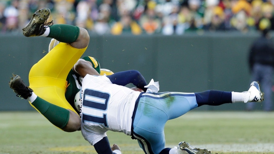 Green Bay Packers' Mike Neal sacks Tennessee Titans quarterback Jake Locker (10) during the second half of an NFL football game Sunday, Dec. 23, 2012, in Green Bay, Wis. (AP Photo/Jeffrey Phelps)