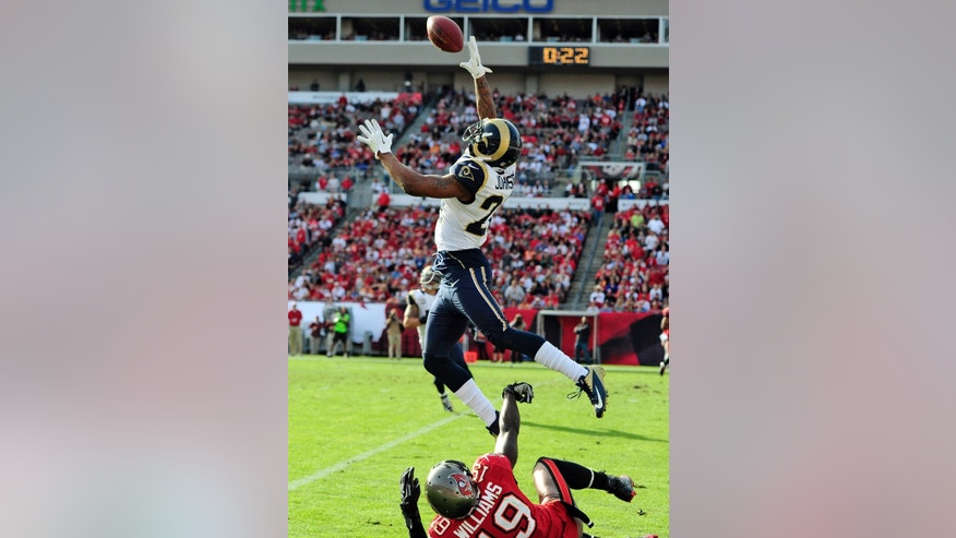 St. Louis Rams cornerback Trumaine Johnson, top, breaks up a pass intended for Tampa Bay Buccaneers wide receiver Mike Williams (19) during the fourth quarter of an NFL football game on Sunday, Dec. 23, 2012, in Tampa, Fla. (AP Photo/Brian Blanco)