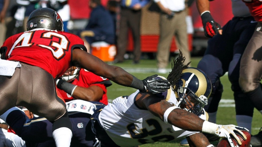 St. Louis Rams running back Steven Jackson (39) dives over the goal line past Tampa Bay Buccaneers free safety Ahmad Black (43) to score a touchdown during the second quarter of an NFL football game on Sunday, Dec. 23, 2012, in Tampa, Fla. (AP Photo/Reinhold Matay)