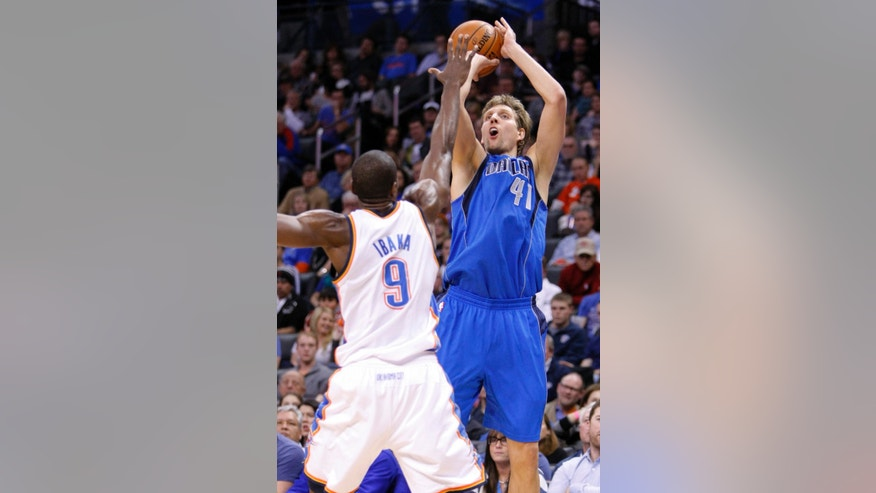 Dallas Mavericks forward Dirk Nowitzki (41) shoots over Oklahoma City Thunder forward Serge Ibaka during the second quarter of an NBA basketball game in Oklahoma City, Thursday, Dec. 27, 2012. (AP Photo/Alonzo Adams)