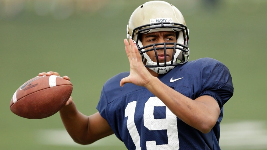 Navy quarterback Keenan Reynolds throws during practice in Oakland, Calif., Wednesday, Dec. 26, 2012.  Navy plays Arizona State in the Fight Hunger Bowl NCAA college football game in San Francisco on Saturday.  (AP Photo/Marcio Jose Sanchez)