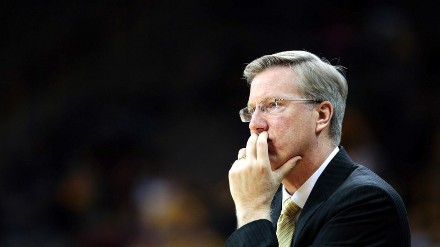 Iowa head coach Fran McCaffery watches as one of his players drives towards the net during the second half an NCAA college basketball game against the Coppin State, Saturday, Dec. 22, 2012, in Iowa City, Iowa. (AP Photo/The Gazette, Kyle Grillot)