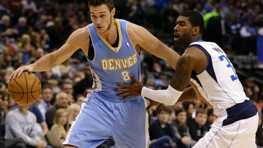 Denver Nuggets small forward Danilo Gallinari (8), of Italy, gets by Dallas Mavericks' O.J. Mayo (32) on a drive to the basket in the first half of an NBA basketball game on Friday, Dec. 28, 2012, in Dallas. (AP Photo/Tony Gutierrez)