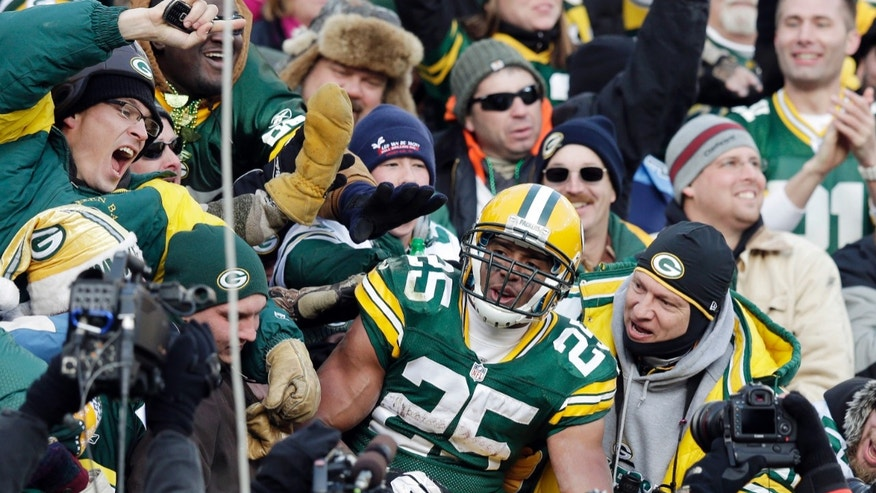 Green Bay Packers' Ryan Grant (25) celebrates with fans after a touchdown run during the second half of an NFL football game against the Tennessee Titans Sunday, Dec. 23, 2012, in Green Bay, Wis. (AP Photo/Morry Gash)