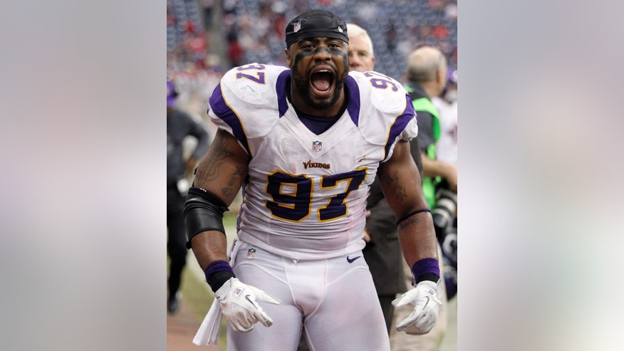 Minnesota Vikings defensive end Everson Griffen (97) celebrates after the Vikings defeated the Houston Texans 23-6 in an NFL football game Sunday, Dec. 23, 2012, in Houston. (AP Photo/Patric Schneider)
