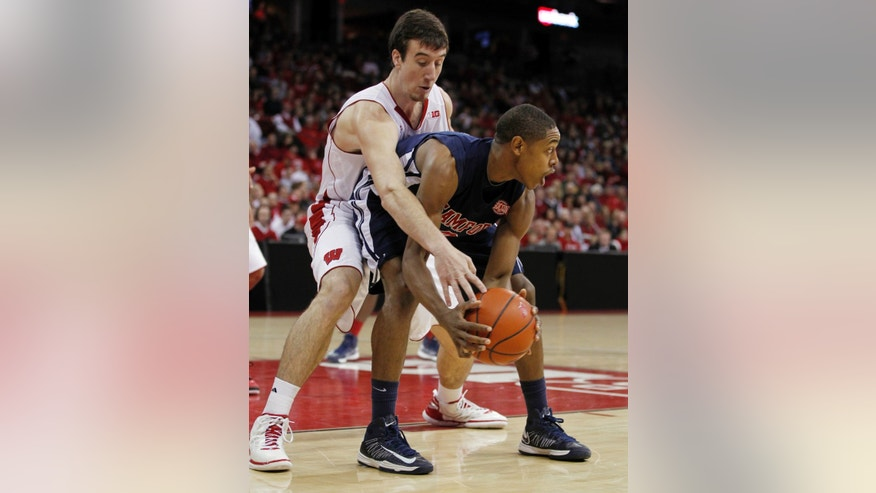 Wisconsin's Frank Kaminsky, behind, reaches in on Samford's Brandon Hayman during the first half of an NCAA college basketball game. Saturday, Dec. 29, 2012, in Madison, Wis. (AP Photo/Andy Manis)