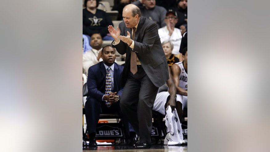 Vanderbilt head coach Kevin Stallings applauds a score against Butler in the first half of an NCAA college basketball game on Saturday, Dec. 29, 2012, in Nashville, Tenn. (AP Photo/Mark Humphrey)