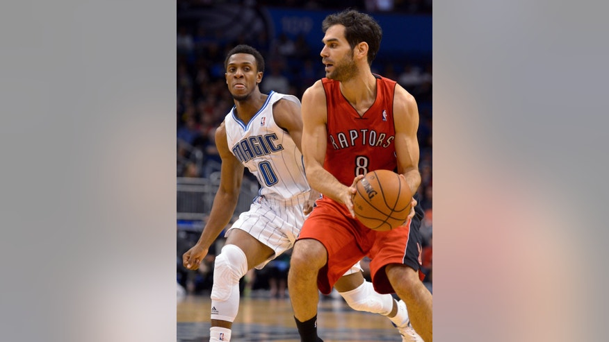 Toronto Raptors guard Jose Calderon (8), of Spain, drives past Orlando Magic guard Ish Smith (10) during the first half of an NBA basketball game in Orlando, Fla., Saturday, Dec. 29, 2012.(AP Photo/Phelan M. Ebenhack)