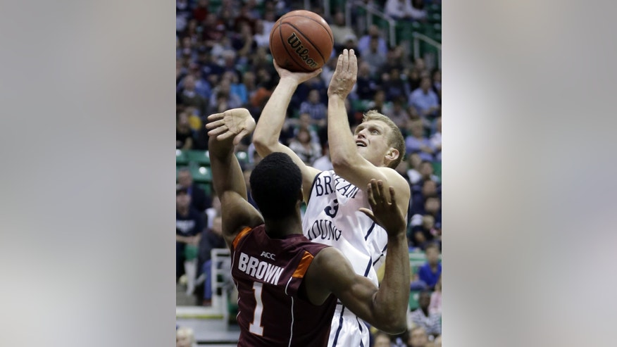 Brigham Young guard Tyler Haws (3) goes to the basket as Virginia Tech guard Robert Brown (1) defends in the second half of an NCAA college basketball game, Saturday, Dec. 29, 2012, in Salt Lake City. BYU defeated Virginia Tech 97-71. Haws scored 42 points. (AP Photo/Rick Bowmer)