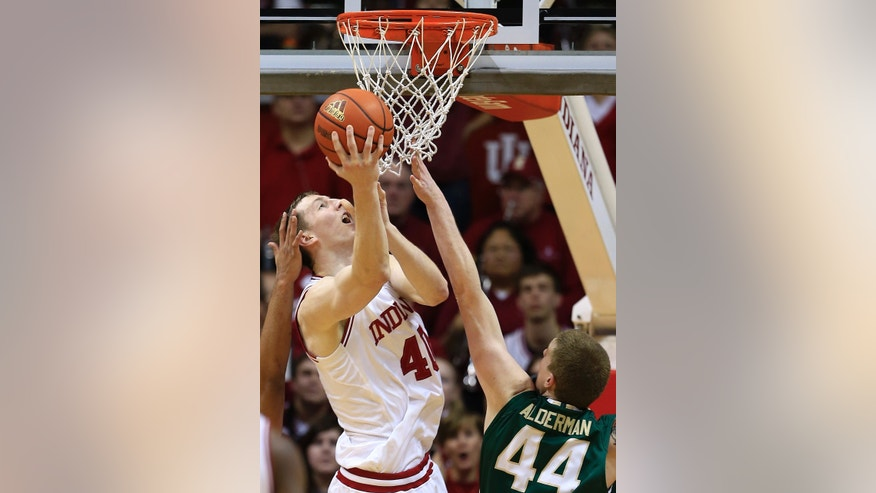 Indiana's Cody Zeller puts up a shot against Jacksonville's Tyler Alderman during the first half of an NCAA college basketball game Friday, Dec. 28, 2012, in Bloomington, Ind. (AP Photo/Darron Cummings)