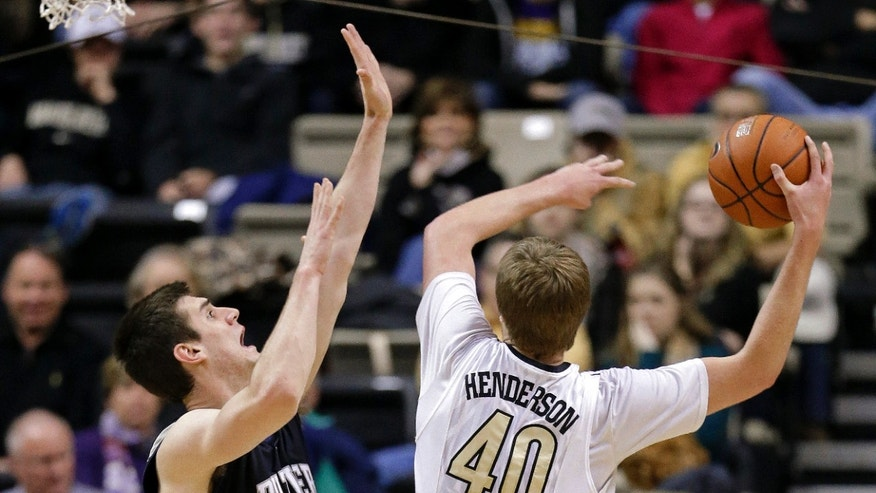 Butler center Andrew Smith (44) blocks the path of Vanderbilt center Josh Henderson (40) in the first half of an NCAA college basketball game on Saturday, Dec. 29, 2012, in Nashville, Tenn. (AP Photo/Mark Humphrey)