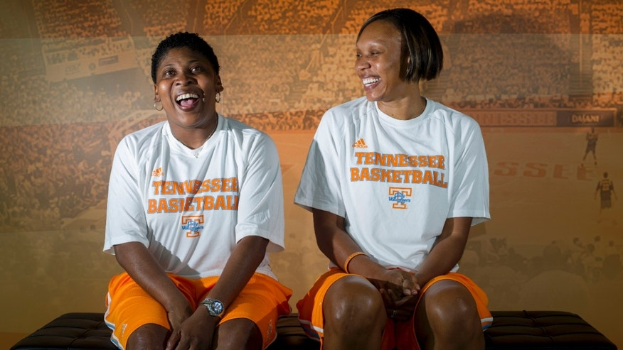 In this photo taken Sept. 5, 2012, University of Tennessee women's basketball assistant coaches Jolette Law, left, and Kyra Elzy pose for a photograph in Knoxville, Tenn.  Law played for C. Vivian Stringer at Iowa, coached alongside her at Rutgers for 12 seasons and even sought her advice on whether to accept an offer to join the Lady Vols' staff. Law will coach against her mentor for the first time Sunday when No. 13 Tennessee hosts Rutgers. (AP Photo/Knoxville News Sentinel, Saul Young)