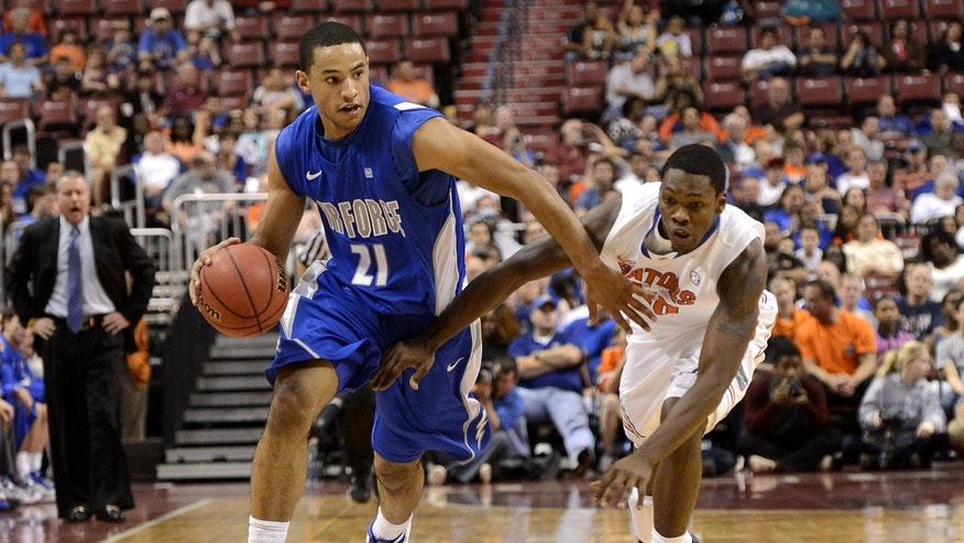 Florida's Michael Frazier II, right, defends Air Force's DeLovell Earls, left, during the first half of an NCAA college basketball game, Saturday, Dec. 29, 2012, in Sunrise, Fla. (AP Photo/Rhona Wise)