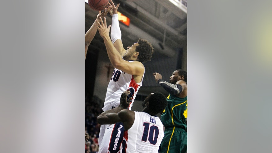 Gonzaga's Elias Harris, left, goes after a rebound during the first half of an NCAA college basketball game against Baylor in Spokane, Wash., on Friday, Dec. 28, 2012. (AP Photo/Young Kwak)