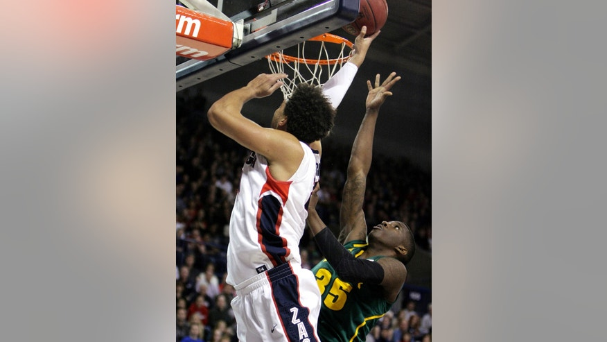 Gonzaga's Elias Harris, left, attempts a layup against Baylor's Taurean Prince during the first half of an NCAA college basketball game in Spokane, Wash., on Friday, Dec. 28, 2012. (AP Photo/Young Kwak)