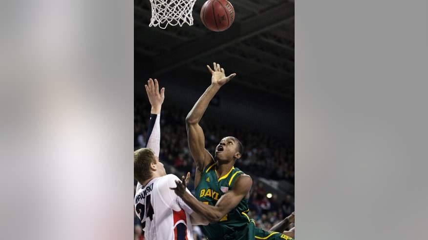 Baylor's Deuce Bello, right, attempts a layup against Gonzaga's Przemek Karnowski during the first half of an NCAA college basketball game in Spokane, Wash., on Friday, Dec. 28, 2012. (AP Photo/Young Kwak)