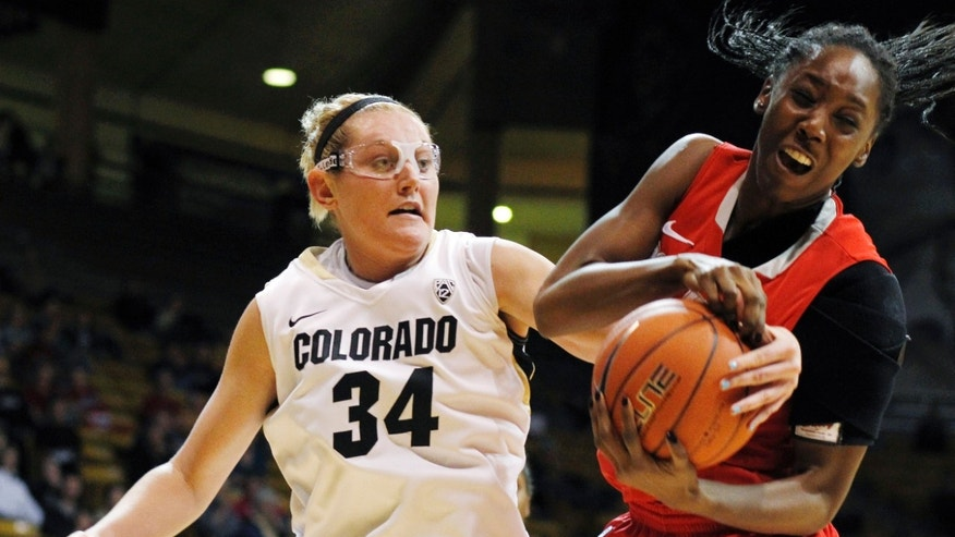 New Mexico forward Chinyere Nnaji, right, battles for control of a rebound with Colorado forward Jen Reese in the second half of Colorado's 84-39 victory in an NCAA college basketball game in Boulder, Colo., on Saturday, Dec. 29, 2012. (AP Photo/David Zalubowski)