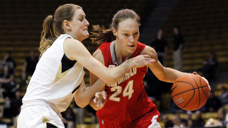 New Mexico guard Caroline Durbin, right, works the ball inside against Colorado guard Lexy Kresl in the first half of an NCAA college basketball game in Boulder, Colo., on Saturday, Dec. 29, 2012. (AP Photo/David Zalubowski)