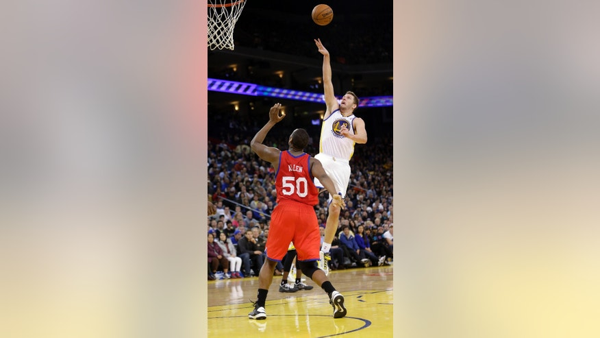 Golden State Warriors' David Lee (10) shoots to score over Philadelphia 76ers' Lavoy Allen (50) during the second half of an NBA basketball game in Oakland, Calif., Friday, Dec. 28, 2012. Golden State won 96-89. (AP Photo/Marcio Jose Sanchez)