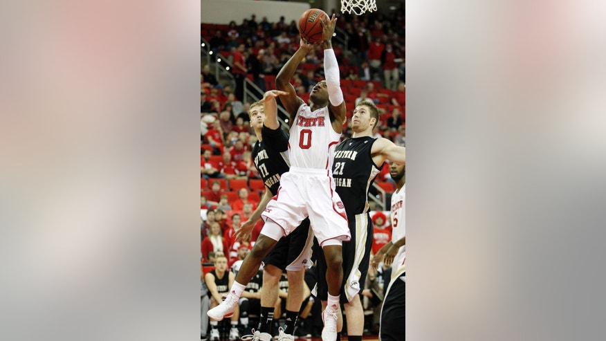 North Carolina State's Rodney Purvis (0) gets his shot off despite the defense of Western Michigan's Nate Hutcheson (11) and Shayne Whittington (21) during the first half of an NCAA college basketball game in Raleigh, N.C., Saturday, Dec. 29, 2012. (AP Photo/Bob Leverone)