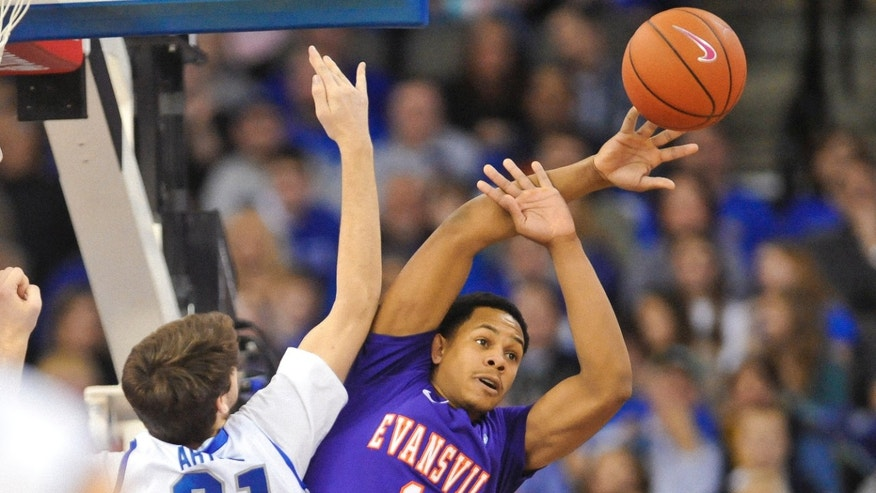 Evansville's Jaylon Moore (10) tries to pass around Creighton's Will Artino (31) during an NCAA college basketball game on Saturday Dec. 29, 2012, in Omaha, Neb. (AP Photo/Dave Weaver)