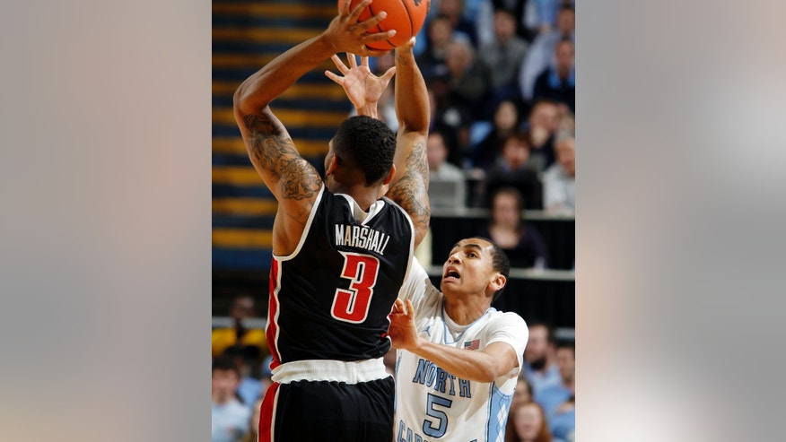 North Carolina guard Marcus Paige (5) battles for position against UNLV guard Anthony Marshall (3) during the first half of an NCAA college basketball game in Chapel Hill, N.C., Saturday, Dec. 29, 2012. (AP Photo/JIm R. Bounds)