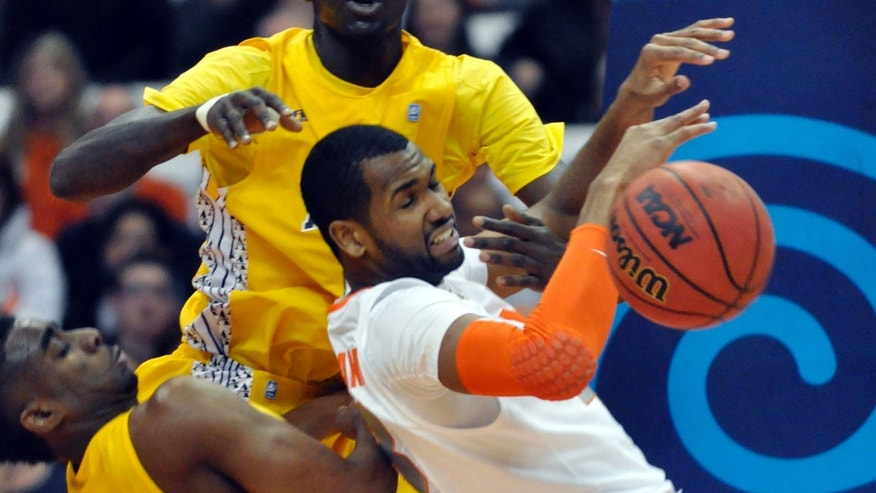 Syracuse's James Southerland loses control of the ball against Alcorn State's Marquiz Baker, left, and Josh Nichols during the first half of an NCAA college basketball game in Syracuse, N.Y., Saturday, Dec. 29, 2012. (AP Photo/Kevin Rivoli)