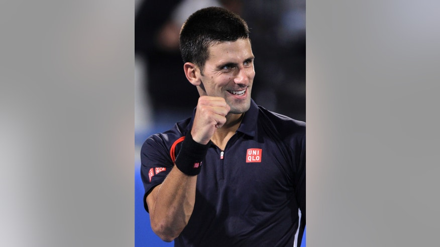 Serbia's Novak Djokovic reacts during a final match against Spain's Nicolas Almagro during the final day of the Mubadala Tennis Championship in Abu Dhabi, United Arab Emirates, Saturday, Dec. 29, 2012. (AP Photo/Kamran Jebreili)